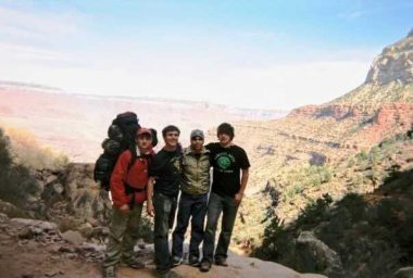 Grand Canyon / Friedreich's Ataxia News / Photo of Matt and three friends standing by the rim of the Grand Canyon.
